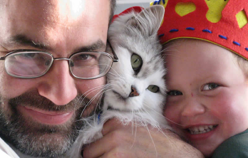 Family Cat - happy cat daddy with daughter and a grey and white cute cat