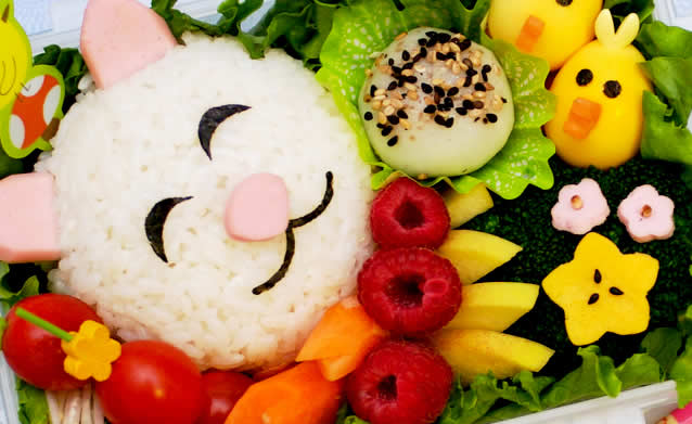 Lunch box with food with a rice cat
